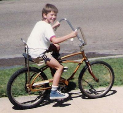 Brady riding a bike as a kid in the 80's.